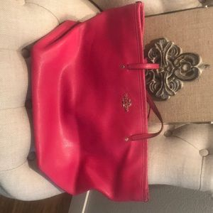 Hot pink Coach tote. Used and has signs of use.